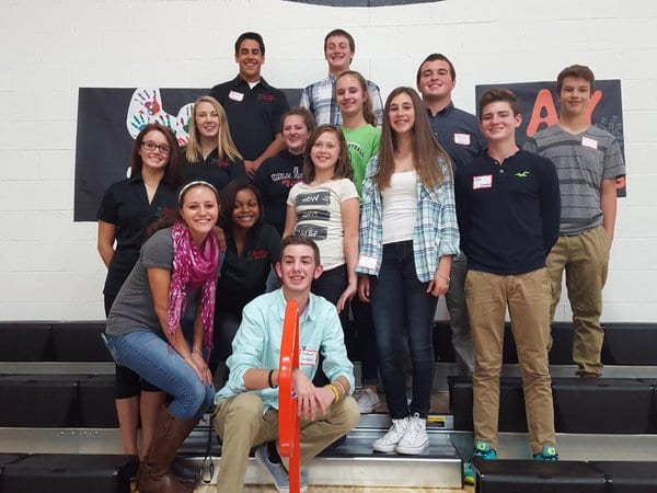 A diverse group of students celebrate Say Something in their school gymnasium. These students from Chardon High School were among the first in Ohio to hold Say Something, back when the program launched in 2015.